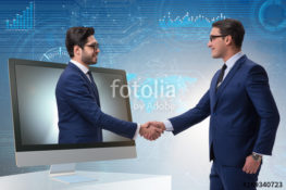 Telepresence concept with two businessman handshaking